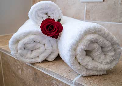 Executive Suite - A rose placed between three rolled towels